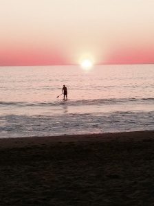 Sunset with a paddle boarder